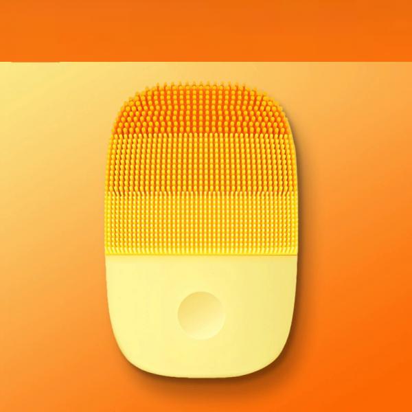 brosse-de-nettoyage-du-visage-orange